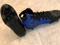 Pair of black-and-blue adidas Cleats