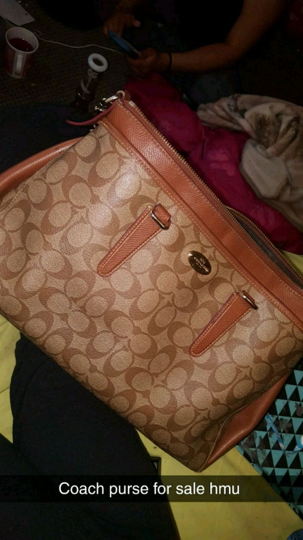 brown monogrammed Coach leather tote bag