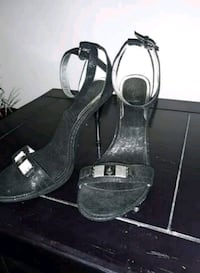 pair of black open-toe ankle strap heels 441 mi