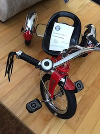 toddler's red and black trike Oakville