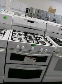 New Kenmore gas stove five burners double oven
