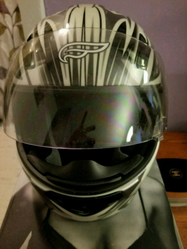 black and gray full-faced motorcycle helmet