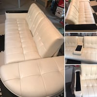Leather sofa turns into bed.  Includes under storage!!  Sherwood Park, T8A 6H2