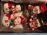 Set of snowman tea light holders.  (4) 589 km