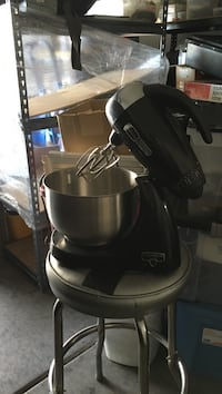black and gray freestanding mixer with silver bowl