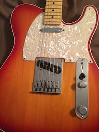 Brown telecaster style electric guitar