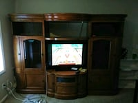 brown wooden TV hutch with flat screen television Leawood, 66224
