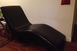 Dark brown leather lounge chair