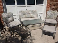 Six piece gray metal framed outdoor funiture set