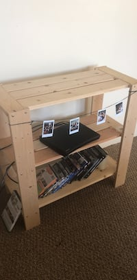 Cute little wooden tv stand