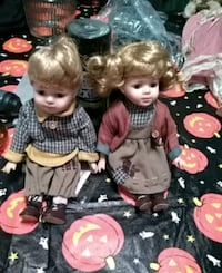 Boy and girl porcelain dolls. Stonington, 62567