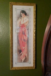 woman in white dress painting with brown wooden frame Edwardsville, 62025
