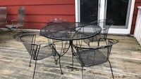 round black metal patio table with four chairs Southbury, 06488