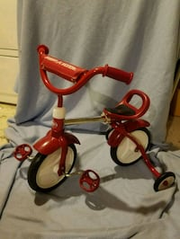 toddler's red and white Radio Flyer trike