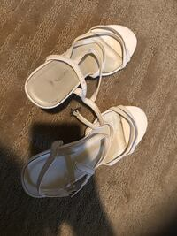pair of white leather open-toe sandals Calgary, T2K 0C4