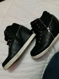 Usedpair of black leather high top sneakers w/heel Brownsville