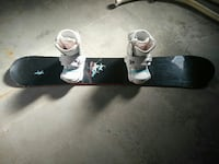 black and white snowboard with bindings
