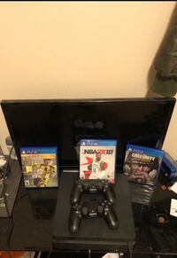 Black sony ps4 console with controller and game cases Reston, 20190