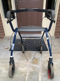 Elderly walker with breaks and seat