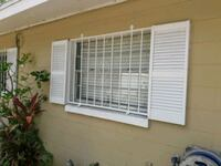 white wooden louvered windows Tampa, 33614