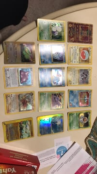 Assorted Rare Holographic Pokemon Cards set of 14. 45 km
