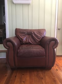 Brown leather sofa chair with ottoman