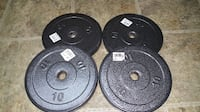 four black weight plates with black barbell Arlington