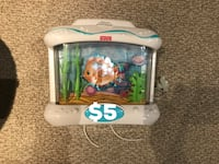 white Fisher-Price electric fish tank table decoration with text overlay Mississauga, L5C 3J5