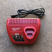 red and black Milwaukee battery charger Cypress, 90630