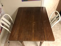 rectangular brown wooden dining table Toronto, M6J 1V9