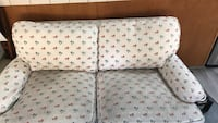 White and red and blue floral love seat. Prescott, 86303