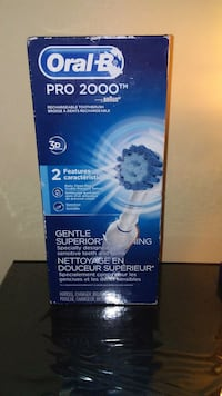 white and blue Oral-B Pro 2000 rechargeable toothb