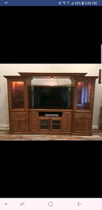 brown wooden TV hutch with flat screen television Springdale, 72764