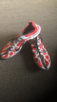 pair of red-and-black Nike running shoes Germantown, 20874