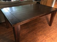 Kittles wood dining table with 4 chairs. Retails for 1500 Chicago, 60608