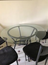 Round glass top table with four chairs Los Angeles