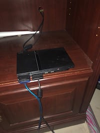PS2 slim , 2 controllers , 5 games Oakville, L6H 7J7
