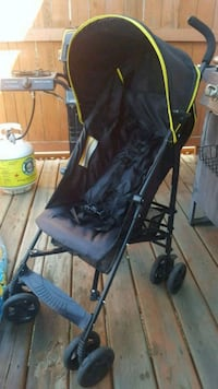 Black and yellow stroller with sun shade  Devon, T9G 2G8