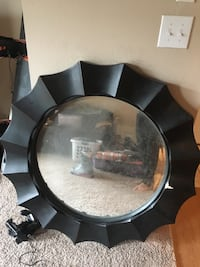 Round black framed mirror