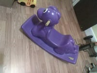 purple plastic animal rocking toy