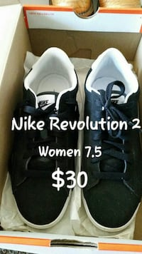 pair of black Nike Revolution 2 shoes with box
