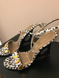 pair of gray-white-and-brown open-toe sling back wedges