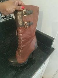 Micheal kors boots( retail $300 )