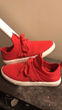 Pair of red running shoes Calgary, T2G 5S2