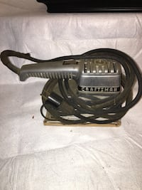 black and gray Craftsman chainsaw Frederick