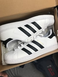 pair of white Adidas Superstar shoes Brockton, 02302