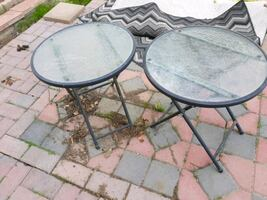 2 glass patio tables