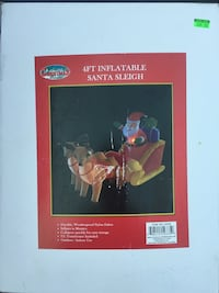 Inflatable Santa in sleigh with reindeer Christmas decoration  Malverne, 11565