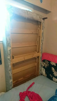 Single bed with box spring on legs  Abbotsford, V2T 3W6