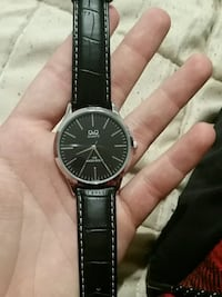 round silver analog watch with black leather strap Ranson